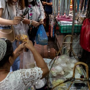 Street vendor and customers in Sampeng Market