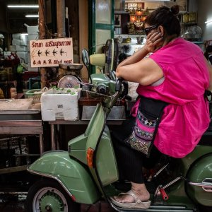 Woman thinking about something on a motorbike