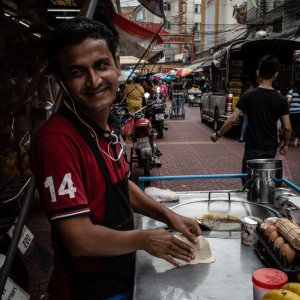 Street vendor getting shy