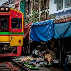 Train coming into Mae klong Railway Market