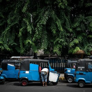 Blue three-wheeled taxi called Bajaj