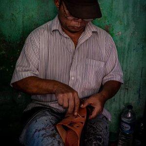 Shoe repairman in the Glodok district