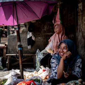 Woman with a hijab working in grocery in Glodok, Jakarta