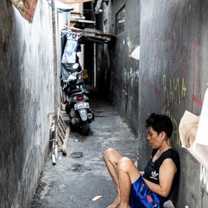 Shopkeeper resting in the lane in Jakarta