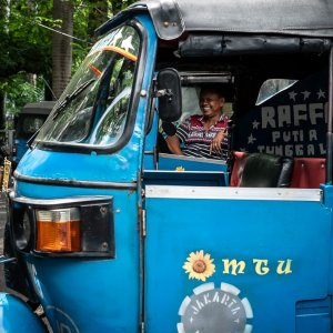 Smiling Bajaj driver