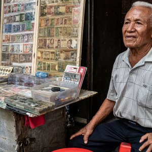 Old man selling old coins and bills in Pasar Baru