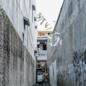 Narrow alleyway between walls