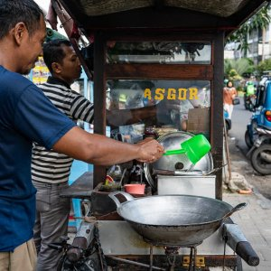 Two men working at a food stall
