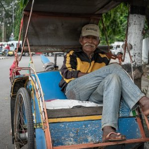 Elderly Becak driver