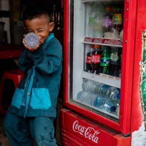 Boy taking aim with a plastic bottle