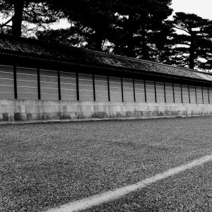 Person with an umbrella walking along the wall of the Kyoto Imperial Palace