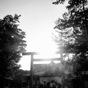 Two shadows in front of Torii in Yasukuni Jinja