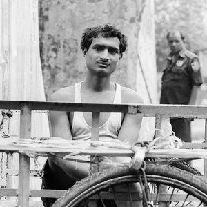 Man sitting on cart