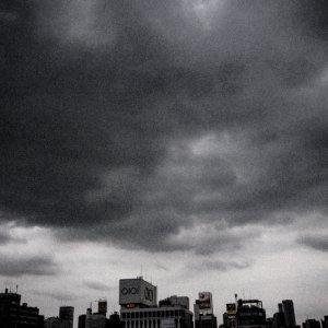 Buildings under dark clouds