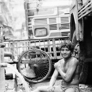 Man washing body by roadside