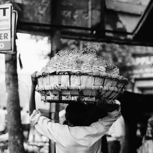 Man carrying big basket on head