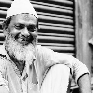 Old man relaxing in front of shutter