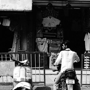 Two motorbikes in front of shop