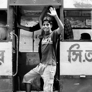Young man jumping in bus