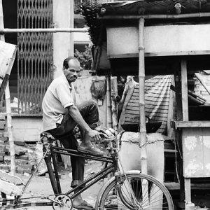 Man riding on cycle rickshaw