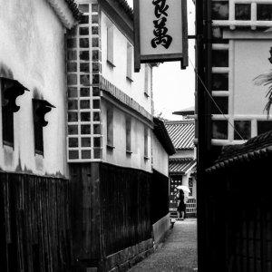 Umbrella at end of lane in Bikan historical quarter