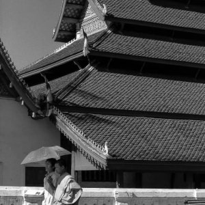 Buddhist monk walking in front of Wat Mai