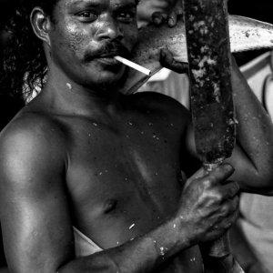 Man striking pose while smoking