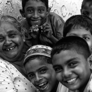 Older woman surrounded by boys