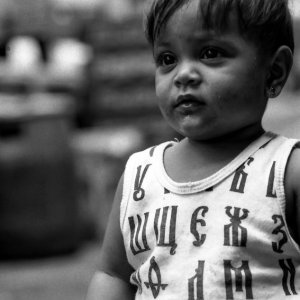 Boy wearing shirt with Cyrillic letters