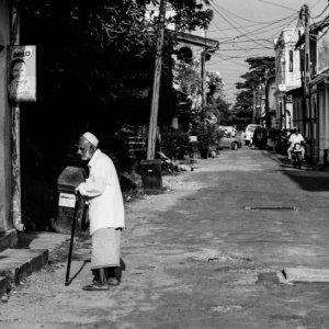 Old man wearing Taqiyah