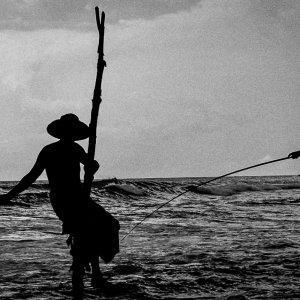Men doing stilt fishing