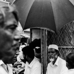 Bearded man under umbrella