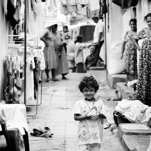 Little girl smiling in lane