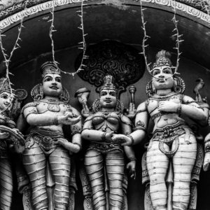 Hindu deities standing on roof of temple