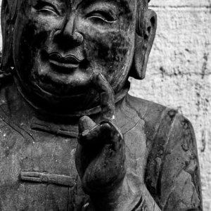 Statue performing endearing gesture