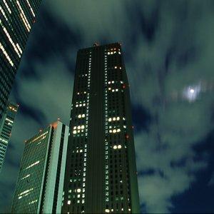 新宿の高層ビル群の間に見える月