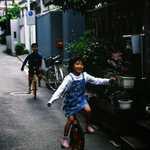 Kids riding unicycle