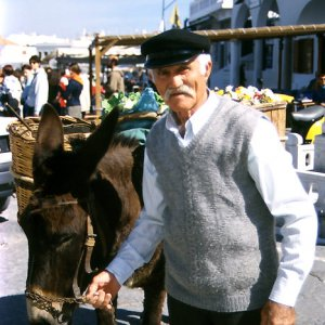 Man with a gorgeous mustache and his donkey