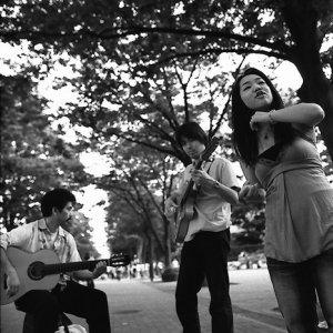 Three street musicians playing