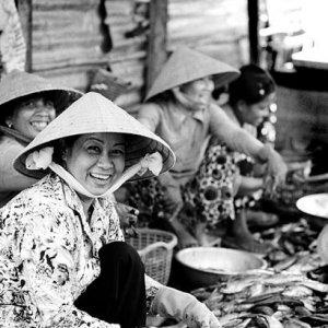 Women cutting fresh-ocean fishes
