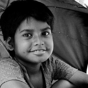 Girl smiling under umbrella