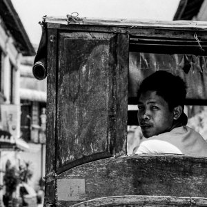 Young coachman looking back on his carriage