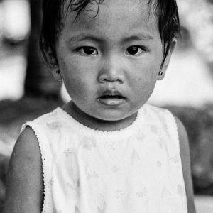 Little girl wearing pierced earrings