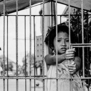 Girl playing in cage