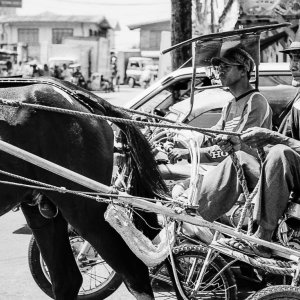 Coachman running in the city of Laoag