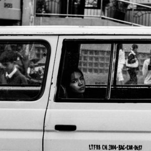 Woman looking out through car window