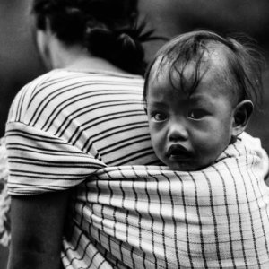 Baby shouldered by mother