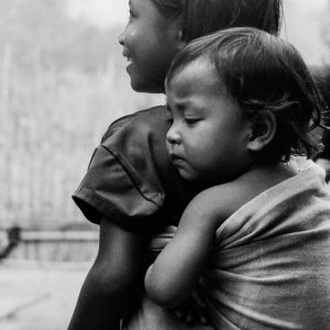 Little girl looking after baby