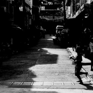 Silhouetted woman crossing street