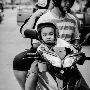 Family riding on same motorbike